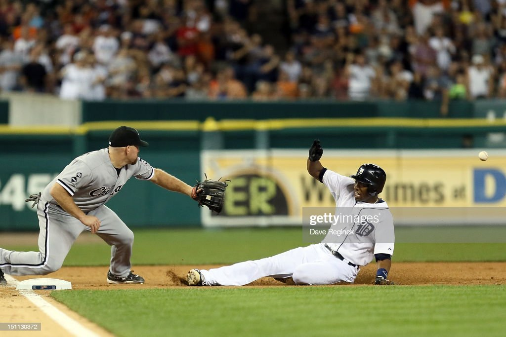 <a gi-track='captionPersonalityLinkClicked' href=/galleries/search?phrase=Austin+Jackson&family=editorial&specificpeople=608633 ng-click='$event.stopPropagation()'>Austin Jackson</a> #14 of the Detroit Tigers slides into third base and beats the tag by Kevin Youlilis #20 of the Chicago White Sox on his eighth inning triple during a MLB game at Comerica Park on September 1, 2012 in Detroit, Michigan. The Tigers won 5-1