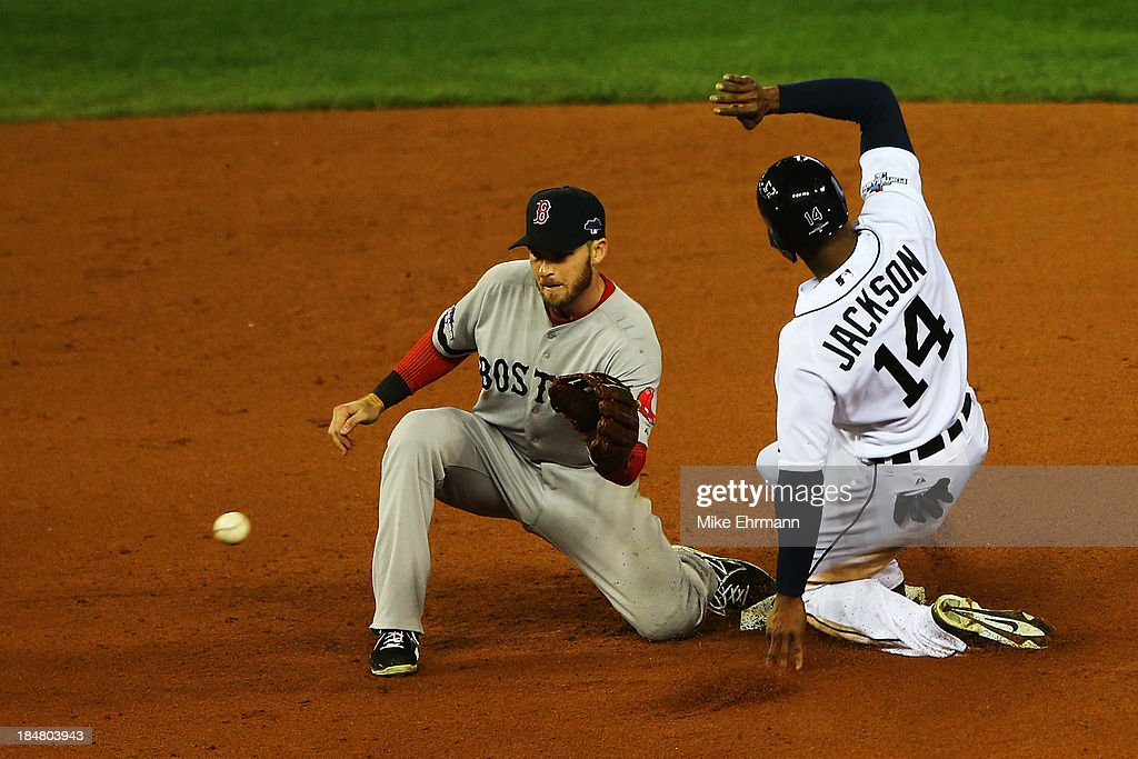 <a gi-track='captionPersonalityLinkClicked' href=/galleries/search?phrase=Austin+Jackson&family=editorial&specificpeople=608633 ng-click='$event.stopPropagation()'>Austin Jackson</a> #14 of the Detroit Tigers steals second base in the fourth inning against <a gi-track='captionPersonalityLinkClicked' href=/galleries/search?phrase=Stephen+Drew&family=editorial&specificpeople=757520 ng-click='$event.stopPropagation()'>Stephen Drew</a> #7 of the Boston Red Sox during Game Four of the American League Championship Series at Comerica Park on October 16, 2013 in Detroit, Michigan.