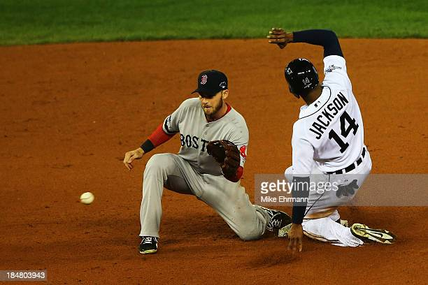 Austin Jackson of the Detroit Tigers steals second base in the fourth inning against Stephen Drew of the Boston Red Sox during Game Four of the...