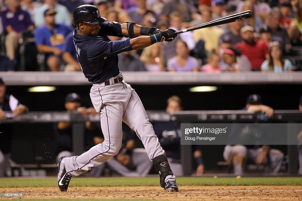 Austin Jackson #16 of the Seattle Mariners hits an RBI single off of Rafael Betancourt #63 of the Colorado Rockies to take a 7-4 lead in the eighth inning during interleague play at Coors Field on August 4, 2015 in Denver, Colorado.