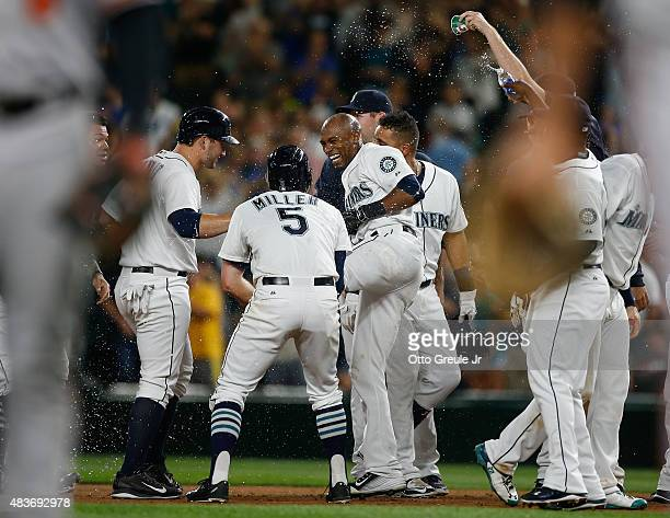 Austin Jackson of the Seattle Mariners is congratulated by teammates after getting the game winning hit to defeat the Baltimore Orioles 65 in ten...