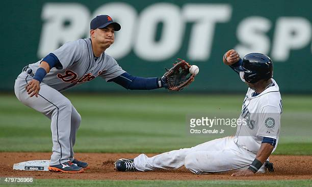 Austin Jackson of the Seattle Mariners steals second base against shortstop Jose Iglesias of the Detroit Tigers in the third inning at Safeco Field...