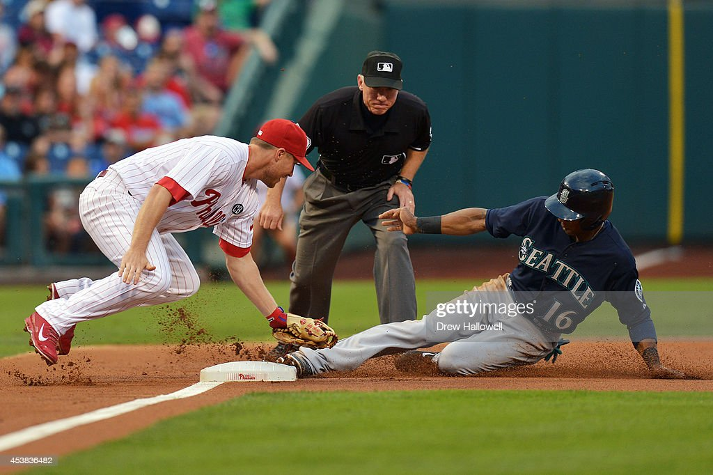 Austin Jackson #16 of the Seattle Mariners steals third base under the tag of Cody Asche #25 of the Philadelphia Phillies in the first inning at Citizens Bank Park on August 19, 2014 in Philadelphia, Pennsylvania.