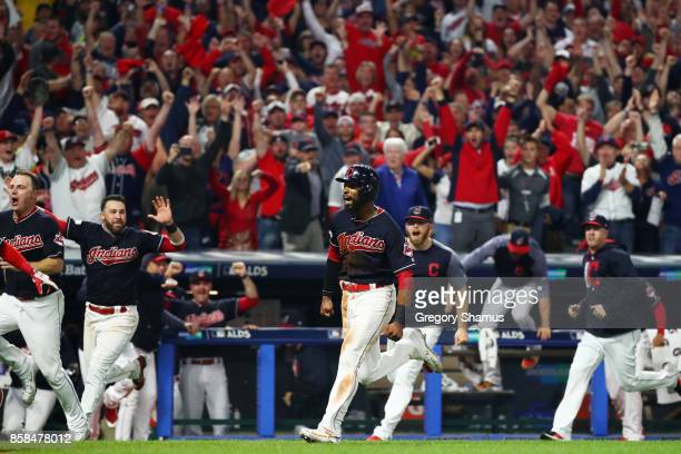 Austin Jackson runs home to score the winning run on a single by Yan Gomes of the Cleveland Indians to win the game 9 to 8 in the 13th inning during...