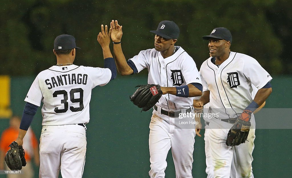 Austin Jackson #14, Torii Hunter #48 and Ramon Santiago #39 of the Detroit Tigers celebrate a win over the Chicago White Sox at Comerica Park on September 20, 2013 in Detroit, Michigan. The Tigers defeated the Sox 12-5.