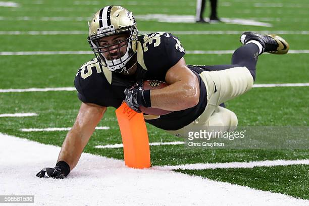 Austin Johnson of the New Orleans Saints dives for a touchdown against the Baltimore Ravens at the MercedesBenz Superdome on September 1 2016 in New...