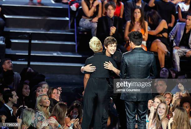 Austin Mahone Adam Lambert and Emeli Sande speak onstage at the 2013 MTV Video Music Awards at the Barclays Center on August 25 2013 in the Brooklyn...