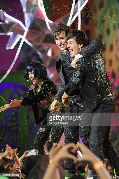 Austin Mahone and Roger Gonzalez get slimed onstage during the Nickelodeon Kids' Choice Awards Mexico 2014 at Pepsi Center WTC on September 20 2014...