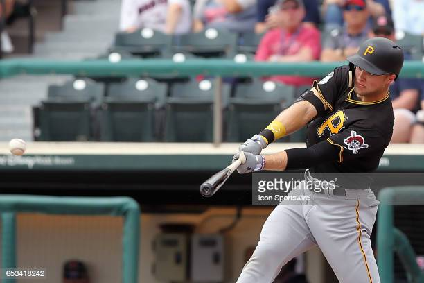 Austin Meadows of the Pirates lines a pitch into the outfield during the spring training game between the Pittsburgh Pirates and the Atlanta Braves...