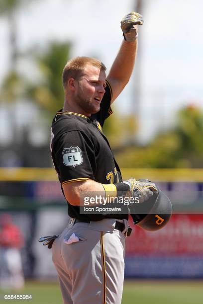 Austin Meadows of the Pirates looks into the stands while on third base during the spring training game between the Pittsburgh Pirates and the...