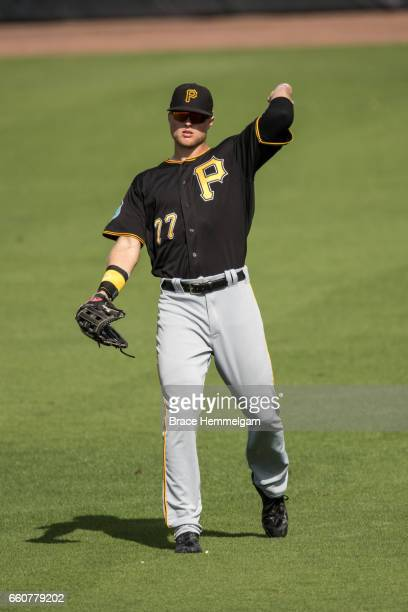 Austin Meadows of the Pittsburgh Pirates throws against the Minnesota Twins on March 1 2017 at the CenturyLink Sports Complex in Fort Myers Florida