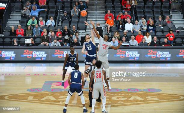 Austin Meyer of the Rice Owls and Brandon McCoy of the UNLV Rebels battle for the opening tipoff as Robert Martin and Connor Cashaw of the Rice Owls...