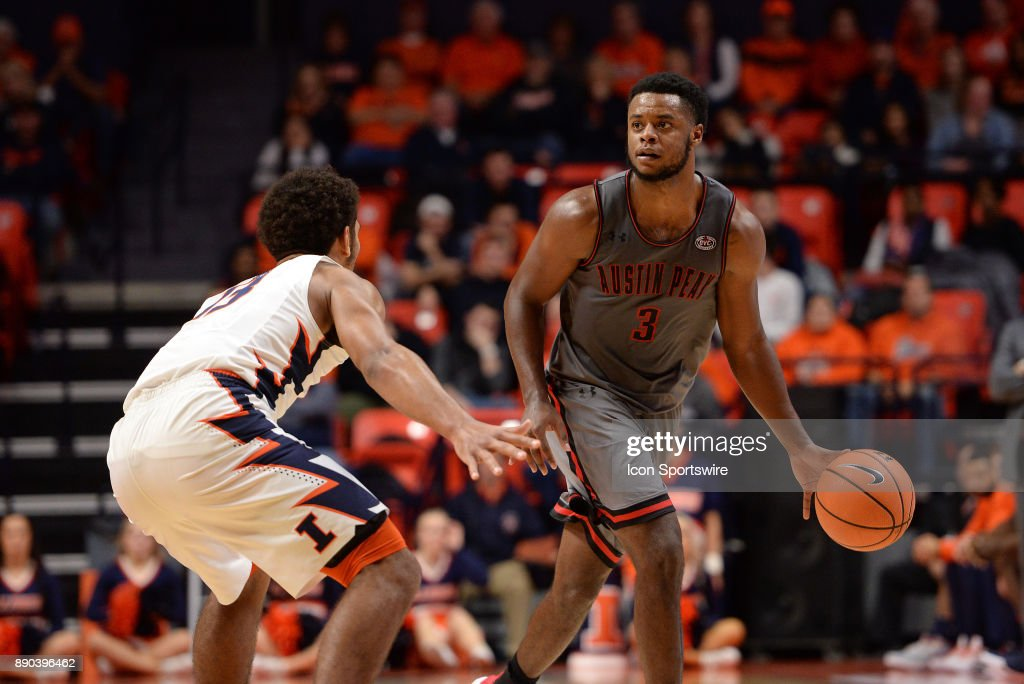 Austin Peay Governors Forward Chris Porter-Bunton (3) is guarded by Illinois Fighting Illini guard Mark Smith (13) during the college basketball game between the Austin Peay Governors and the Illinois Fighting Illini on December 6, 2017, at the State Farm Center in Champaign, Illinois.