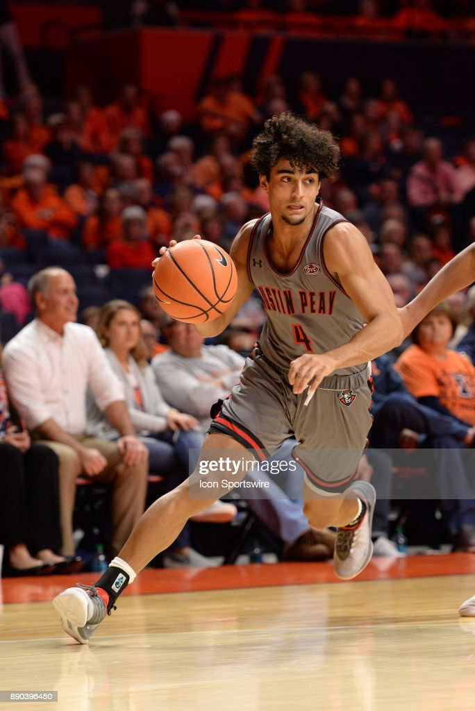 Austin Peay Governors Guard Dayton Gumm (4) dribbles toward the basket during the college basketball game between the Austin Peay Governors and the Illinois Fighting Illini on December 6, 2017, at the State Farm Center in Champaign, Illinois.