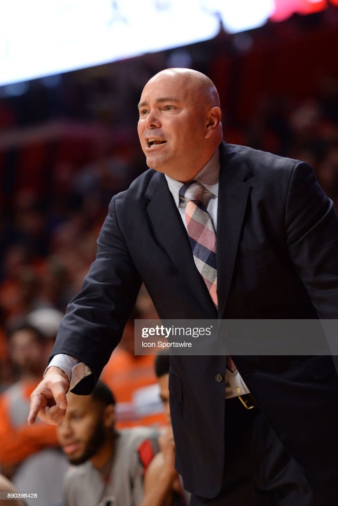 Austin Peay Governors head coach Matt Figger points to the base line telling a player to move during the college basketball game between the Austin Peay Governors and the Illinois Fighting Illini on December 6, 2017, at the State Farm Center in Champaign, Illinois.