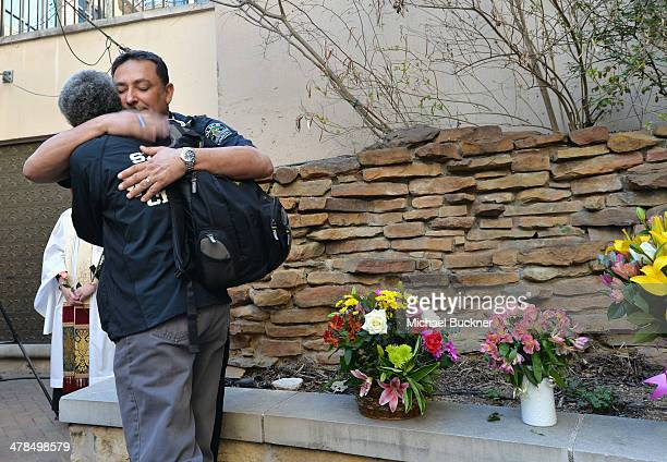 Austin Police Chief Art Acevedo hugs another mourner at prayer service at St David's Episcopal Church following a deadly car accident at the South by...