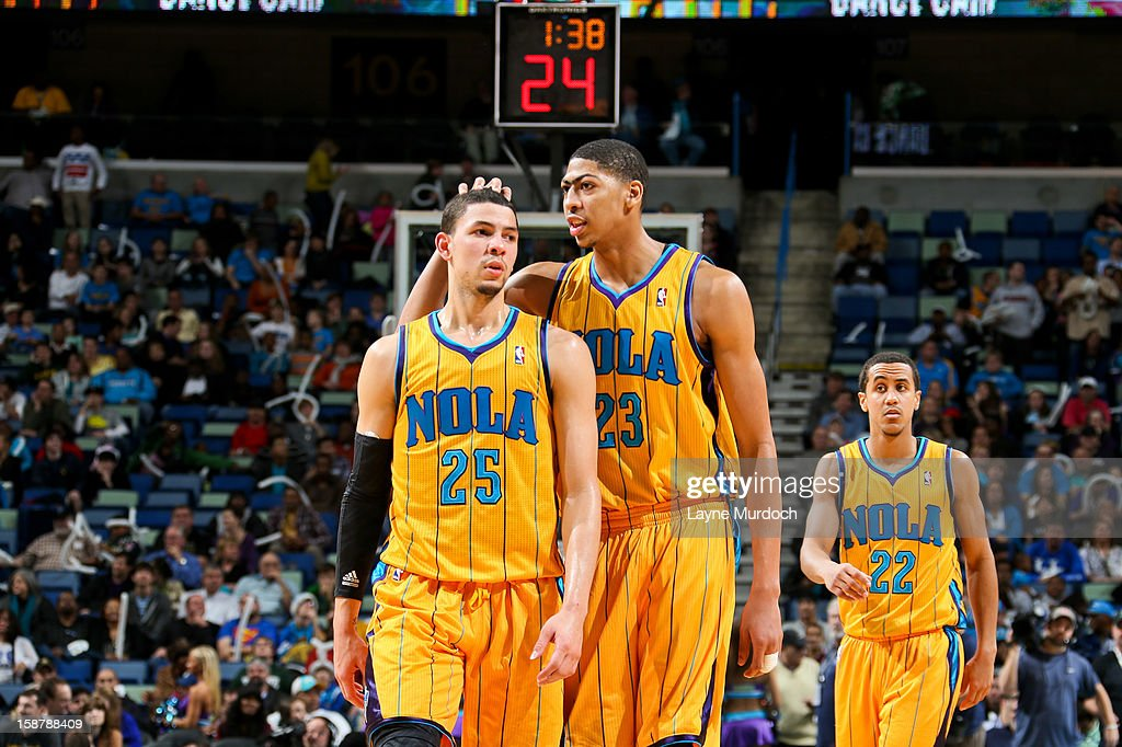 Austin Rivers #25 and Anthony Davis #23 of the New Orleans Hornets speak before resuming play in the fourth quarter against the Toronto Raptors on December 28, 2012 at the New Orleans Arena in New Orleans, Louisiana.