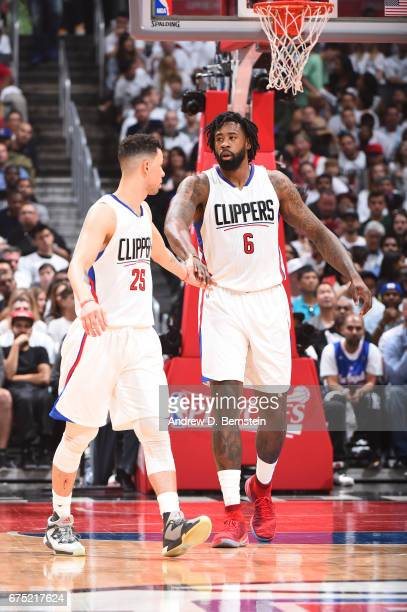 Austin Rivers and DeAndre Jordan of the LA Clippers celebrate during Game Seven of the Western Conference Quarterfinals of the 2017 NBA Playoffs on...