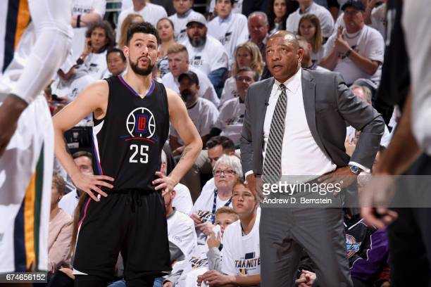 Austin Rivers and Doc Rivers of the Los Angeles Clippers talk during the game against the Utah Jazz during Game Six of the Western Conference...