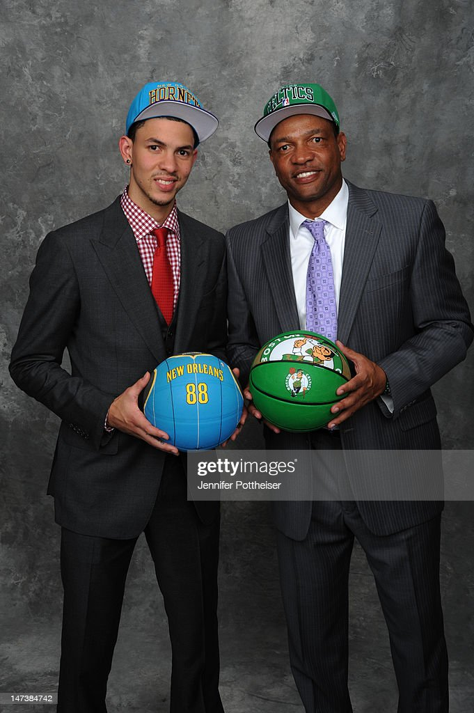 Austin Rivers and his father Doc poses for a portrait after being selected number ten overall by the New Orleans Hornets during the 2012 NBA Draft at...