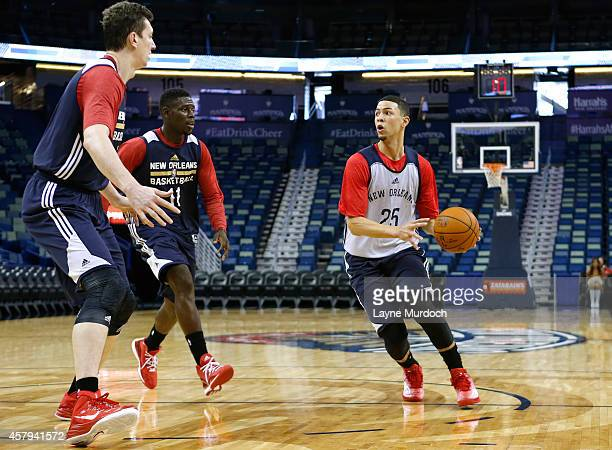 Austin Rivers looks to pass against Omer Asik and Jrue Holiday of the New Orleans Pelicans hold an open practice for fans on October 25 2014 at the...