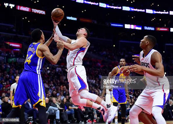 Austin Rivers of the LA Clippers is fouled on his layup by Shaun Livingston of the Golden State Warriors during a 11598 Warriors win at Staples...