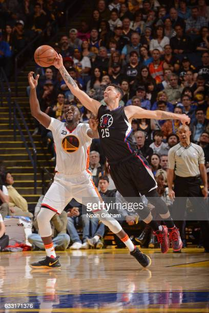 Austin Rivers of the LA Clippers steals the pass from Draymond Green of the Golden State Warriors on January 28 2017 at oracle Arena in Oakland...