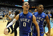 Austin Rivers of the Duke Blue Devils celebrates with teammate Quinn Cook after hitting a gamewinning 3 pointer to defeat the North Carolina Tar...