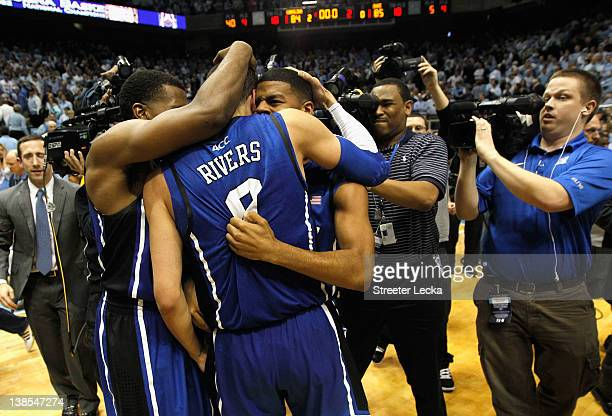 Austin Rivers of the Duke Blue Devils celebrates with teammates after hitting a gamewinning 3 pointer to defeat the North Carolina Tar Heels 8584...