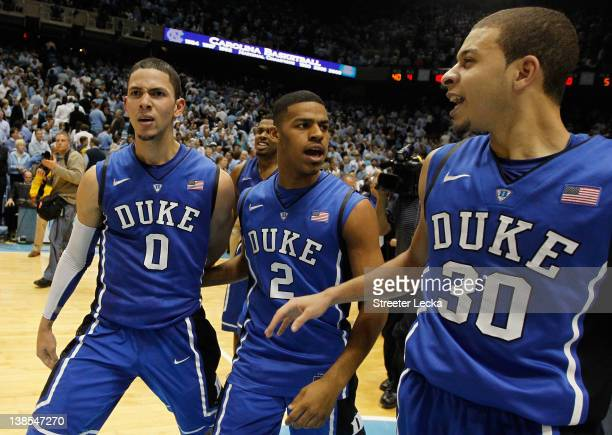 Austin Rivers of the Duke Blue Devils celebrates with teammates Seth Curry and Quinn Cook after hitting a gamewinning 3 pointer to defeat the North...
