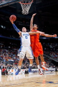 Austin Rivers of the Duke Blue Devils drives for a shot attempt in the first half against Jarell Eddie of the Virginia Tech Hokies in their...