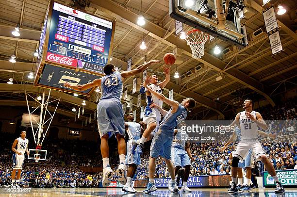 Austin Rivers of the Duke Blue Devils drives to the basket against the North Carolina Tar Heels during their game at Cameron Indoor Stadium on March...