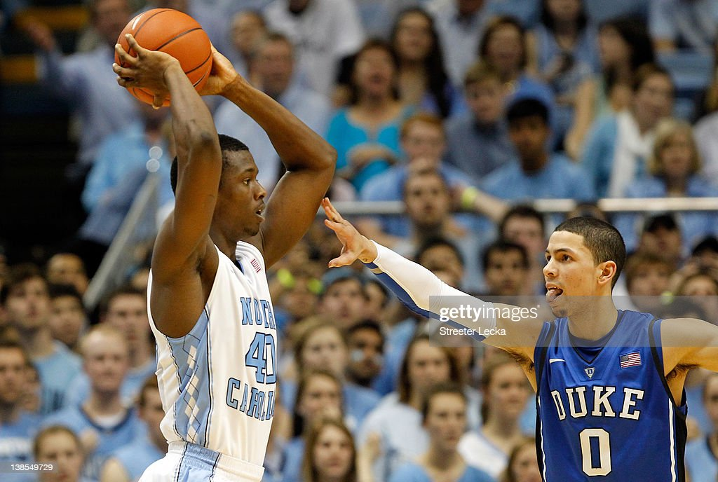 Austin Rivers of the Duke Blue Devils guards Harrison Barnes of the North Carolina Tar Heels during their game at the Dean Smith Center on February 8...