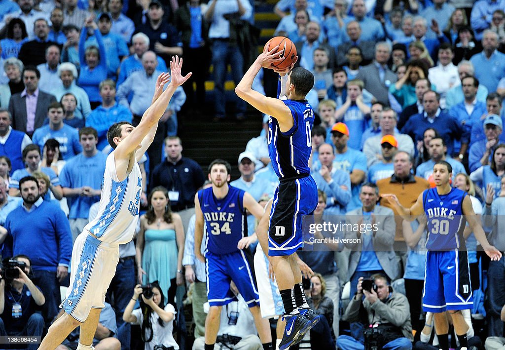 Austin Rivers #0 of the Duke Blue Devils launches his last-second, game-winning 3-point basket over Tyler Zeller #44 of the North Carolina Tar Heels at the Dean Smith Center on February 8, 2012 in Chapel Hill, North Carolina. Duke won 85-84.