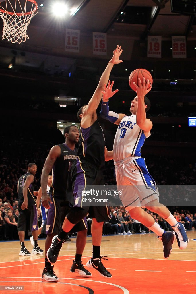 Austin Rivers of the Duke Blue Devils shoots over Abdul Gaddy of the Washington Huskies at Madison Square Garden on December 10 2011 in New York City