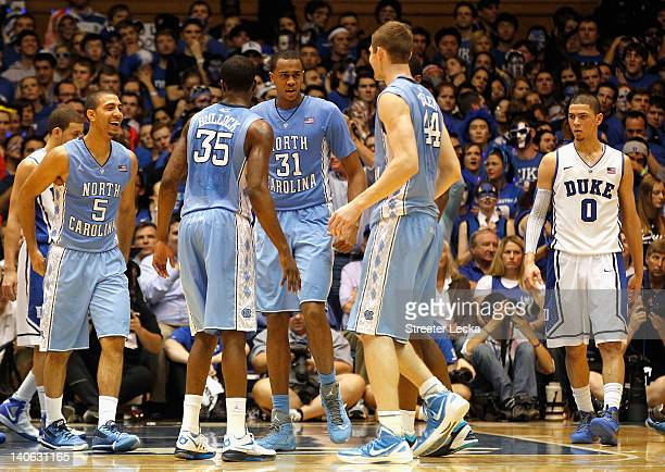 Austin Rivers of the Duke Blue Devils watches as the North Carolina Tar Heels celebrate a 8870 victory at Cameron Indoor Stadium on March 3 2012 in...