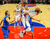 Austin Rivers of the Los Angeles Clippers drives to the basket and scores against Dirk Nowitzki of the Dallas Mavericks during the second quarter of...