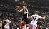 Austin Rivers of the Los Angeles Clippers drives to the basket on AlFarouq Aminu of the Portland Trail Blazers as CJ McCollum and Mason Plumlee of...