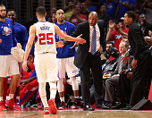 Austin Rivers of the Los Angeles Clippers is greeted by head coach Doc Rivers as he comes off the floor against the Houston Rockets during Game Three...