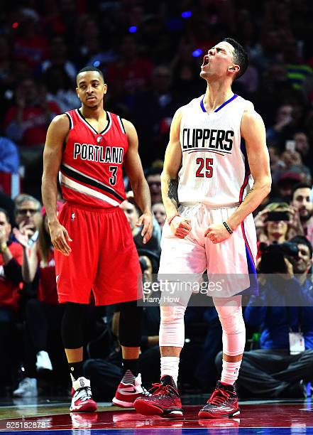 Austin Rivers of the Los Angeles Clippers reacts to his basket and foul in front of CJ McCollum of the Portland Trail Blazers in Game Five of the...