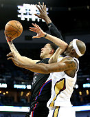 Austin Rivers of the Los Angeles Clippers shoots against Dante Cunningham of the New Orleans Pelicans during the second half at the Smoothie King...