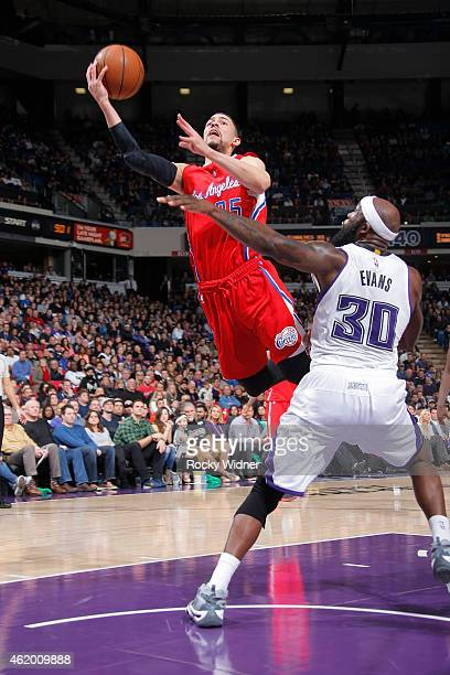 Austin Rivers of the Los Angeles Clippers shoots against Reggie Evans of the Sacramento Kings on January 17 2015 at Sleep Train Arena in Sacramento...
