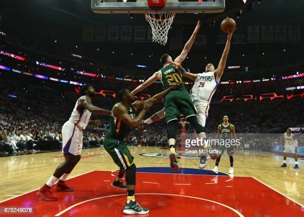 Austin Rivers of the Los Angeles Clippers shoots over Gordon Hayward of the Utah Jazz during the first half of Game Seven of the Western Conference...