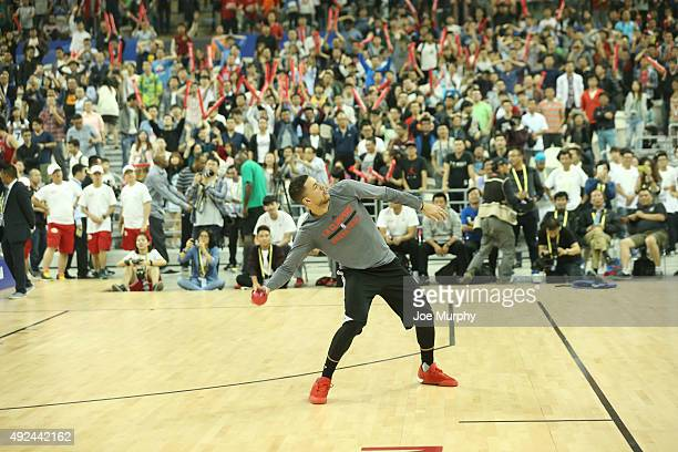 Austin Rivers of the Los Angeles Clippers tosses balls to fans during Fan Appreciation Day as part of the 2015 NBA Global Games China at the Oriental...