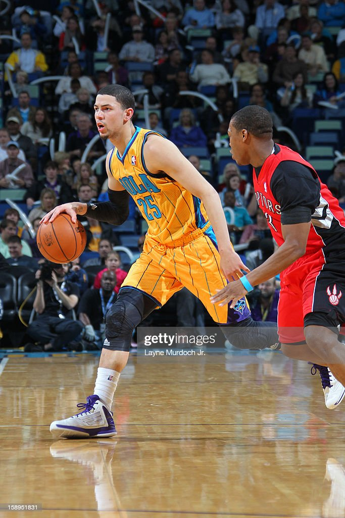 <a gi-track='captionPersonalityLinkClicked' href=/galleries/search?phrase=Austin+Rivers&family=editorial&specificpeople=7117574 ng-click='$event.stopPropagation()'>Austin Rivers</a> #25 of the New Orleans Hornets brings the ball up court against the Toronto Raptors on December 28, 2012 at the New Orleans Arena in New Orleans, Louisiana.