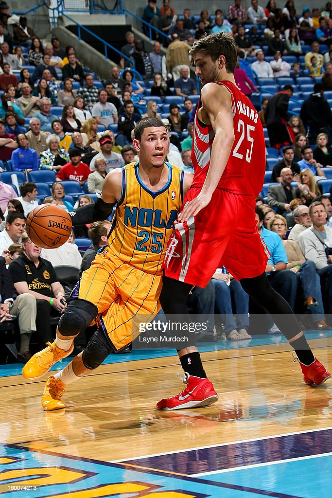 <a gi-track='captionPersonalityLinkClicked' href=/galleries/search?phrase=Austin+Rivers&family=editorial&specificpeople=7117574 ng-click='$event.stopPropagation()'>Austin Rivers</a> #25 of the New Orleans Hornets drives against <a gi-track='captionPersonalityLinkClicked' href=/galleries/search?phrase=Chandler+Parsons&family=editorial&specificpeople=4249869 ng-click='$event.stopPropagation()'>Chandler Parsons</a> #25 of the Houston Rockets on January 25, 2013 at the New Orleans Arena in New Orleans, Louisiana.