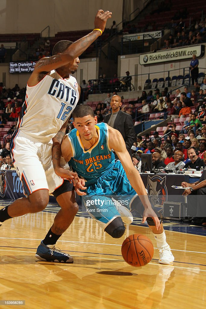 <a gi-track='captionPersonalityLinkClicked' href=/galleries/search?phrase=Austin+Rivers&family=editorial&specificpeople=7117574 ng-click='$event.stopPropagation()'>Austin Rivers</a> of the New Orleans Hornets drives against <a gi-track='captionPersonalityLinkClicked' href=/galleries/search?phrase=Tyrus+Thomas&family=editorial&specificpeople=453285 ng-click='$event.stopPropagation()'>Tyrus Thomas</a> #12 of the Charlotte Bobcats at the North Charleston Coliseum on October 11, 2012 in North Charleston, South Carolina.