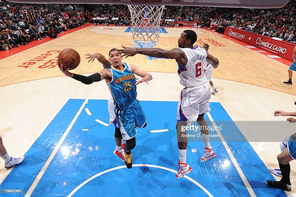 <a gi-track='captionPersonalityLinkClicked' href=/galleries/search?phrase=Austin+Rivers&family=editorial&specificpeople=7117574 ng-click='$event.stopPropagation()'>Austin Rivers</a> #25 of the New Orleans Hornets drives to the basket against <a gi-track='captionPersonalityLinkClicked' href=/galleries/search?phrase=DeAndre+Jordan&family=editorial&specificpeople=4665718 ng-click='$event.stopPropagation()'>DeAndre Jordan</a> #6 of the Los Angeles Clippers at Staples Center on December 19, 2012 in Los Angeles, California.