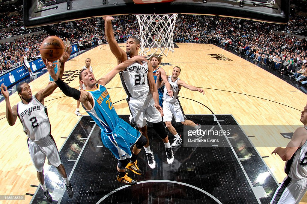 <a gi-track='captionPersonalityLinkClicked' href=/galleries/search?phrase=Austin+Rivers&family=editorial&specificpeople=7117574 ng-click='$event.stopPropagation()'>Austin Rivers</a> #25 of the New Orleans Hornets drives to the basket against <a gi-track='captionPersonalityLinkClicked' href=/galleries/search?phrase=Tim+Duncan&family=editorial&specificpeople=201467 ng-click='$event.stopPropagation()'>Tim Duncan</a> #21 of the San Antonio Spurs on December 21, 2012 at the AT&T Center in San Antonio, Texas.