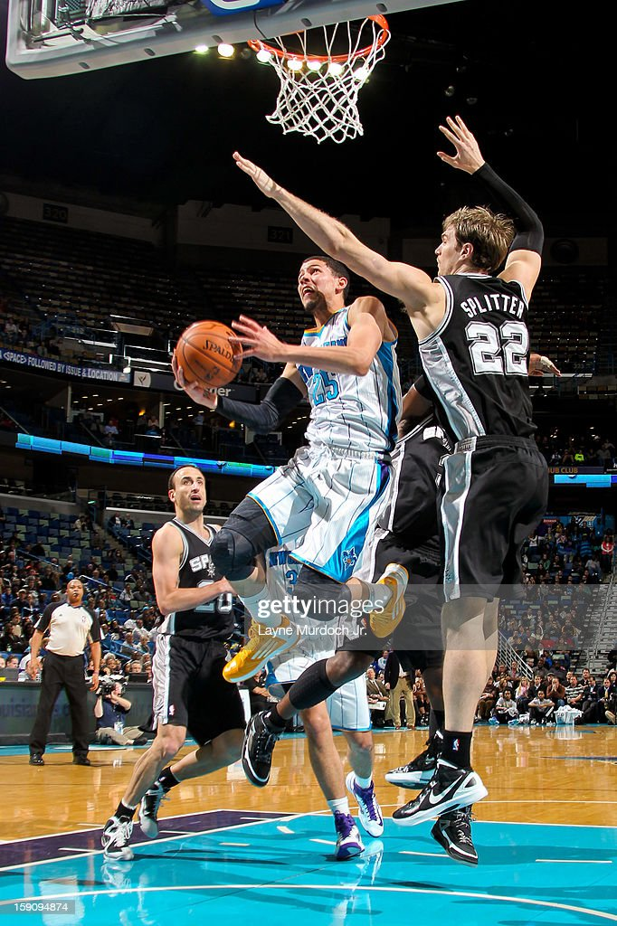 Austin Rivers #25 of the New Orleans Hornets drives to the basket against Tiago Splitter #22 of the San Antonio Spurs on January 7, 2013 at the New Orleans Arena in New Orleans, Louisiana.